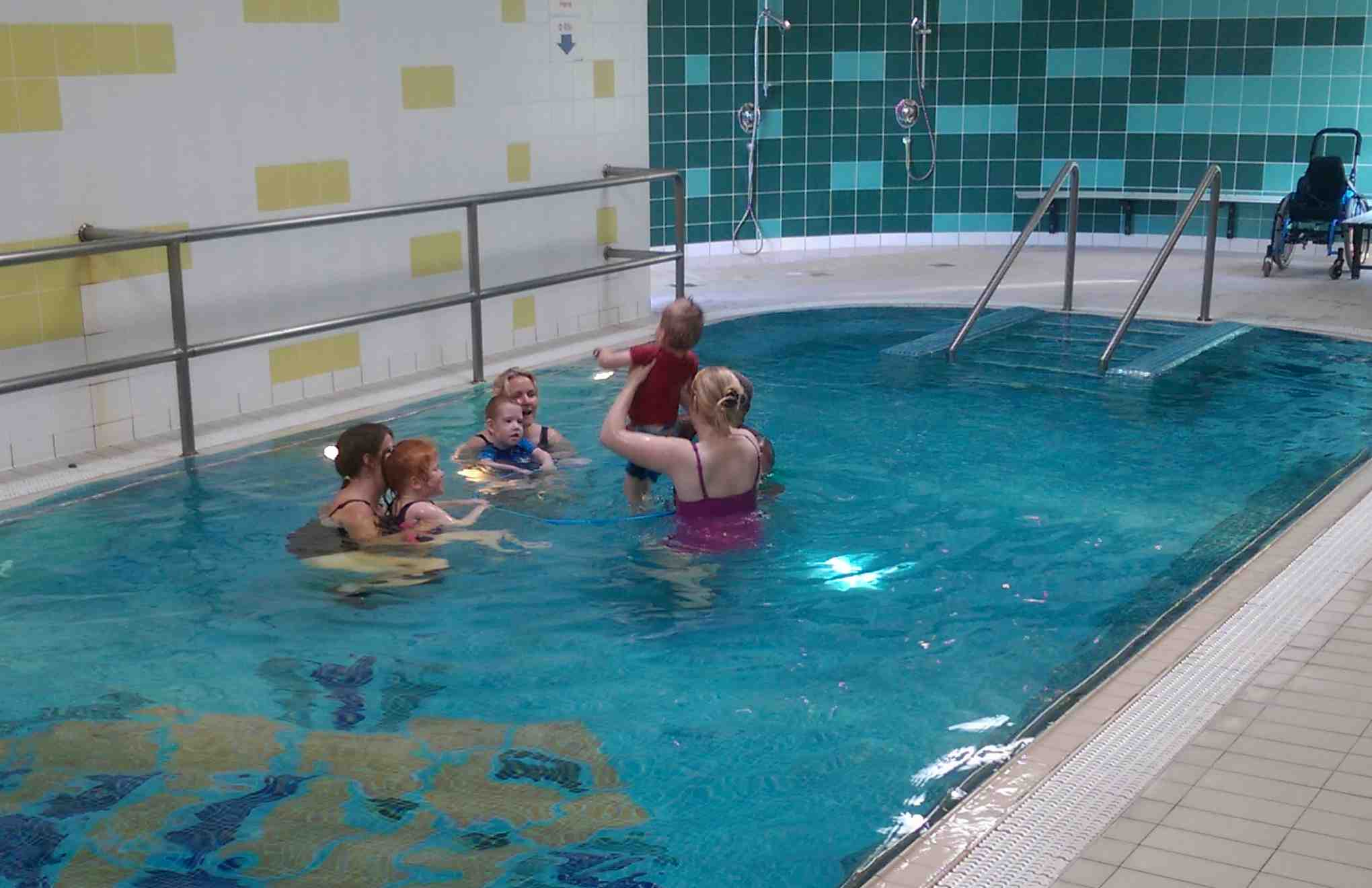 Young children with therapists in hydrotherapy pool