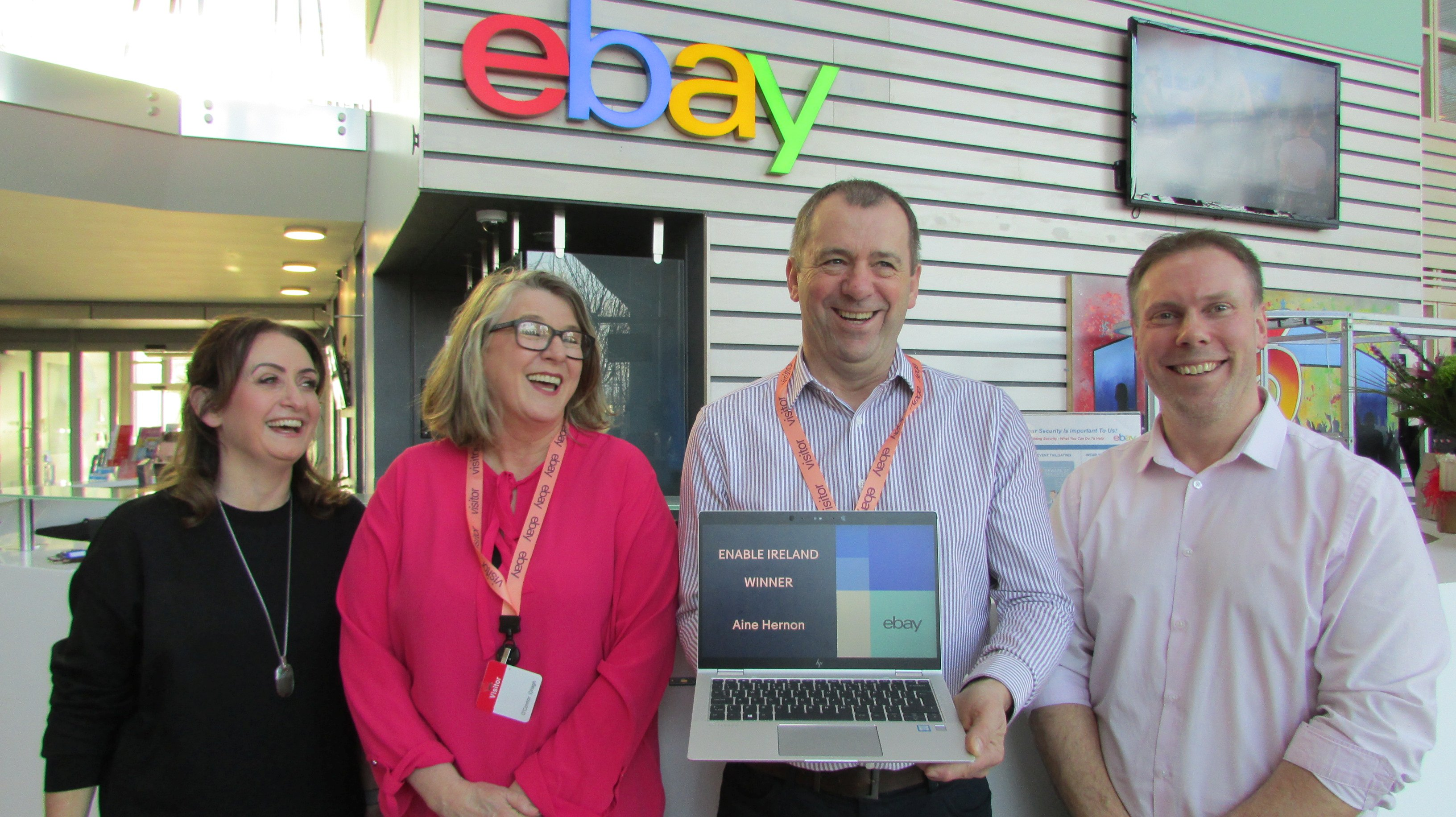 Four people from Enable Ireland and eBay announce the winner of the charity raffle