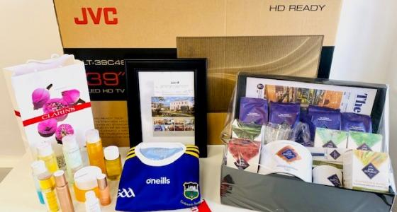 Image shows a selection of prizes in a hamper.