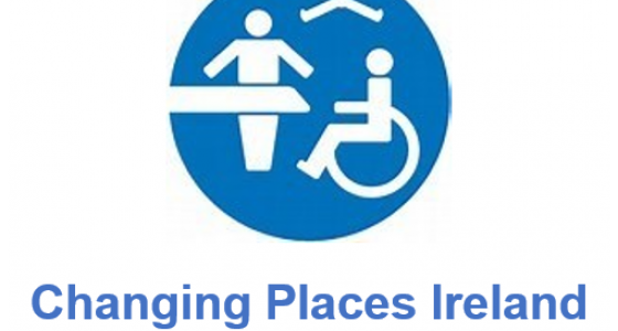 Logo with person at a changing bench, hoist and wheelchair user