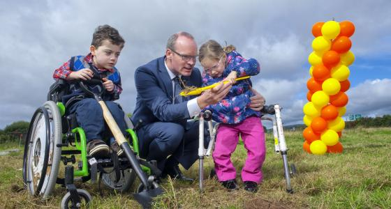 Minister Simon Coveney with Darragh Cashman and Susie Hayes at the sod turning on the site of the planned children's centre in Curraheen