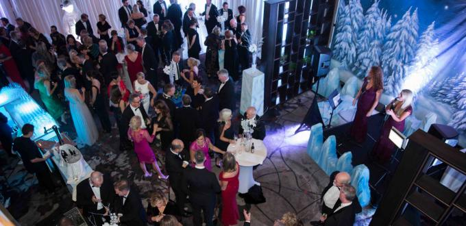 Aerial shot of attendees at fire and ice theme ball