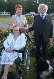 Margaret in wheelchair with her sister, President Higgins and his dog