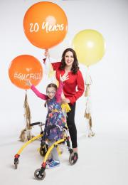 Grainne Seioge and Rachael Doak (8) holding balloons to launch Give Up Clothes For Good 2017