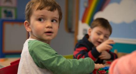Two boys playing at a table in pre-school