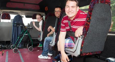 Adults traveling together on an Enable Ireland bus